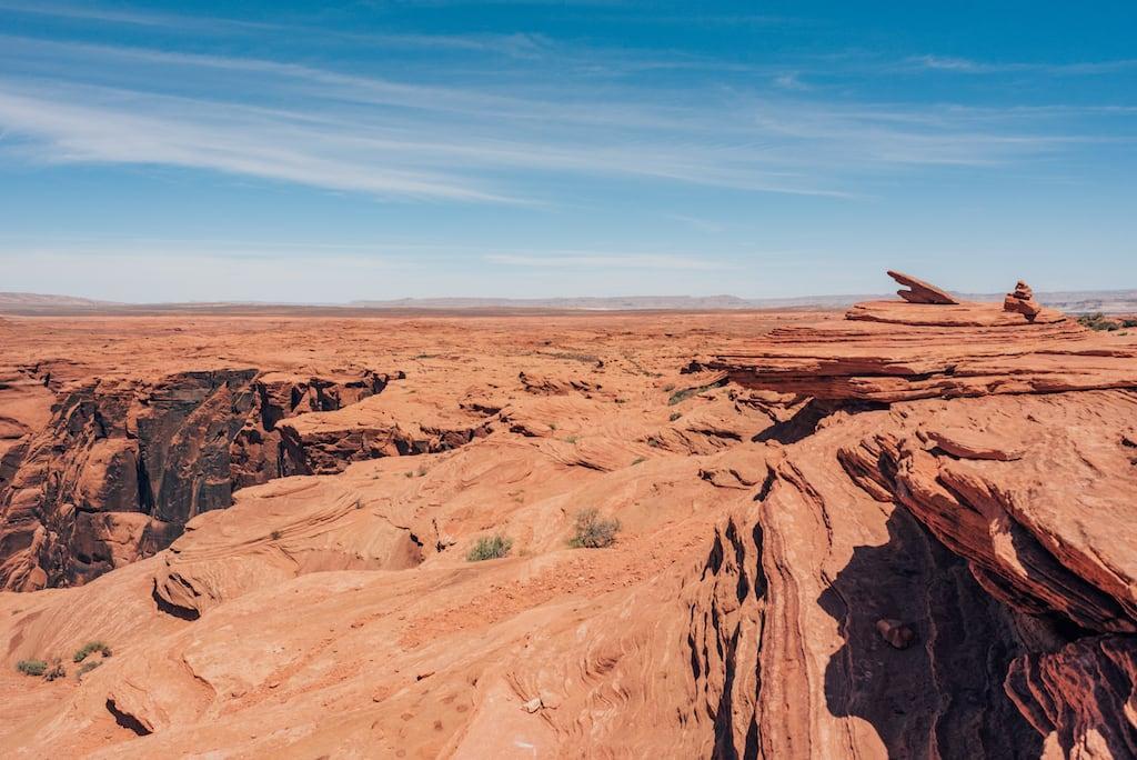 Rochas vermelhas no deserto, próximo ao Horseshoe Bend. Venha conhecer mais sobre esse lugar! #HorseshoeBend #Desert